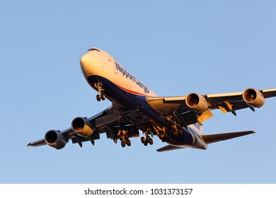 CHICAGO, ILLINOIS / USA - November 25, 2017: Nippon Cargo (NCA) Boeing 747-8F on final approach to O'Hare International Airport completing its long distance flight from Asia at sunset.