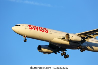 CHICAGO, ILLINOIS / USA - November 25, 2017: A wide-body Swiss Airlines Airbus 330 arriving at O'Hare International Airport in late afternoon sunlight. Final moments of its long-distance flight.