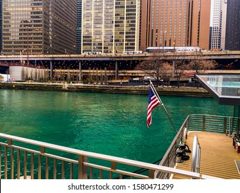 CHICAGO, ILLINOIS, USA - NOVEMBER 29, 2019: The Chicago River in Chicago, Illinois. The Chicago River serves as the main link between the Great Lakes and the Mississippi Valley waterways.
