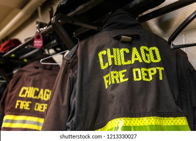CHICAGO, ILLINOIS, USA - OCTOBER 10, 2018: The fireman's clothes by the real squad fire truck in Chicago Fire Department at the quarters of Engine Co. 5. The legendary series 'Chicago Fire' reportage