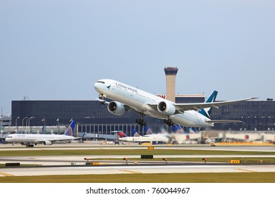 CHICAGO, ILLINOIS / USA - October 13, 2017: Cathay Pacific Airlines Boeing 777-300 passenger jet taking off from O'Hare International Airport to begin it's flight to Hong Kong.