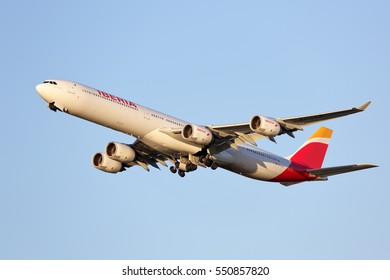 Chicago, Illinois, USA - October 23, 2015 - An Iberia Airbus A340 is taking off from runway 28R at the Chicago O'Hare International Airport late in the afternoon.  This is an Airbus A340-600