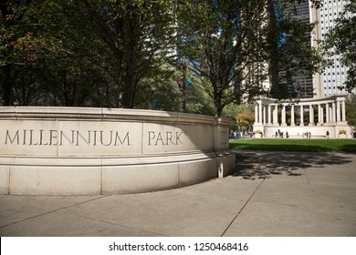 Chicago, Illinois / USA - October 28 2017: Wide angle view on the Millennium Park sign at the entrance to Wrigley Square, with the Millennium Monument in the background