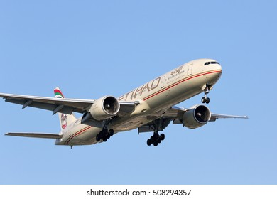 CHICAGO, ILLINOIS / USA - October 9, 2016: Etihad Airways Boeing 777-300 approaching the runway at O'Hare Airport during regular passenger flight to Chicago. These aircraft make daily flights to ORD.