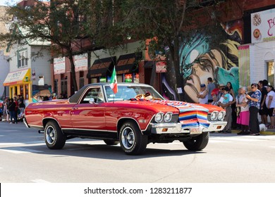 Chicago, Illinois, USA - September 15, 2018: Pilsen Mexican Independence Day Parade, A chevrolet, el camino, with mexican flag, sombrero and zarape, going down the street