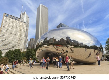 CHICAGO, ILLINOIS, USA - September 24, 2015: Tourists at the Cloud Gate, a sculpture by artist Anish Kapoor, Millennium Park, Chicago, Illinois, USA