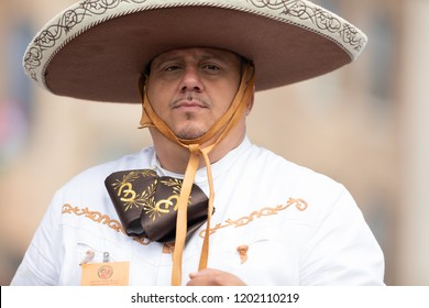 Chicago, Illinois , USA - September 9, 2018 The 26th Street Mexican Independence Parade, mexican man wearing traditional charro clothing riding a horse down the street