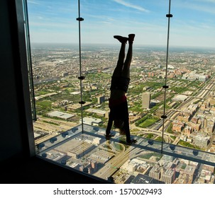 CHICAGO, ILLINOIS, USA:  Tourist standing upside down on the Skydeck Ledge at Willis Tower, a popular tourist destination, as seen on May 24, 2014.