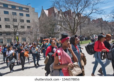 Chicago, Illinois, USA-April 20,2018: Students, faculty and citizens march against gun violence and protest Chicago Mayor Rahm Emanuel on the University of Chicago Campus.