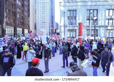Chicago, Illinois / USA-May 1, 2020: Protesters gather in front of the James R. Thompson Center in Chicago to protest the stay at home order issued by Governor J.B. Pritzker demanding their rights.