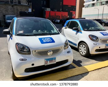 CHICAGO, ILLINOIS/APRIL 23, 2019: Daimler's Car2Go ShareNow vehicles parked in River North lot by expressway entrance