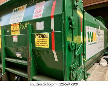 CHICAGO, ILLINOIS/DECEMBER 25, 2018: Waste Management trash compactor services hotel complex in Loop
