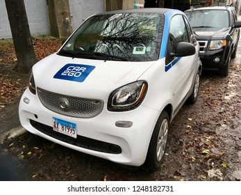 CHICAGO, ILLINOIS/DECEMBER 3, 2018: Car2Go vehicle parks on leaf covered pavement at near west side Green street hourly parking zone