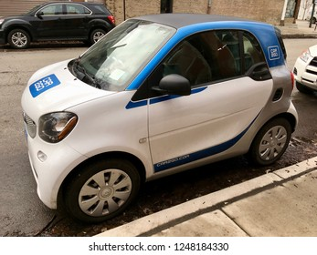 CHICAGO, ILLINOIS/DECEMBER 3, 2018: Car2Go vehicle parks on pavement at near west side Green street hourly parking zone