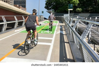CHICAGO, ILLINOIS/JULY 8, 2019: Cyclists ride up Navy Pier flyover ramps newly restriped for summer traffic at East Illinois Street flyover