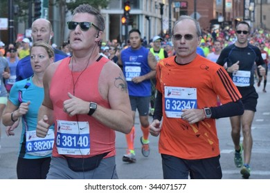 CHICAGO, ILLINOIS/USA â??OCTOBER 11, 2015: Chicago Bank of America Marathon runners on October 11, 2015 in Chicago near north Loop.
