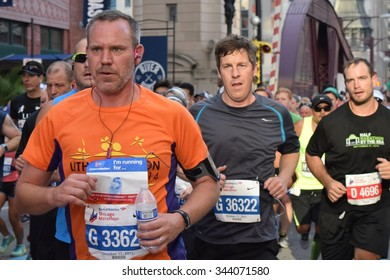 CHICAGO, ILLINOIS/USA â??OCTOBER 11, 2015: Chicago Bank of America Marathon male runners on October 11, 2015 in Chicago near north Loop.