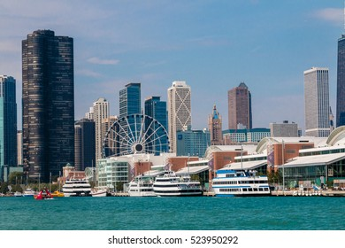 Chicago, Illinois,USA - 16th September 2016:Navy pier with its cruise ships and tour boats and ferris wheel in front of the Chicago skyline