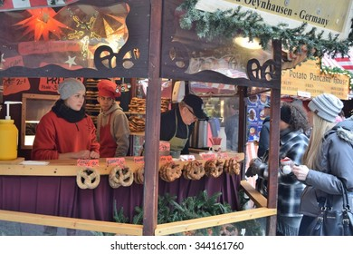 CHICAGO, ILLINOIS/USA â??OCTOBER 20, 2015: German pretzel stand serving customers in Chicago Christmas market on October 20, 2015 in Chicago Loop