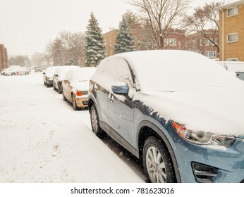 CHICAGO ILLINOIS,USA - DECEMBER 24, 2017: Cars under snow in Chicago, ILL during massive Winter Storm Thor