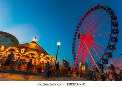 Chicago, Illinois/USA - June 2016: A ferris wheel and merry-go-round lit up at the Navy Pier at night
