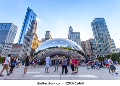 Chicago, Illinois/USA - June 2018: People crowd around the Cloud Gate, also known at The Bean, a mirrored sculpture found at the Millennium Park in Chicago