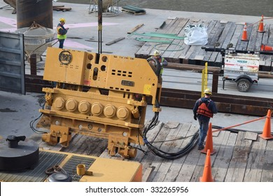 CHICAGO, ILLINOIS/USA   OCTOBER 25, 2015: Barge workers prepare heavy machinery for lift on October 25, 2015 by Loop riverwalk expansion.
