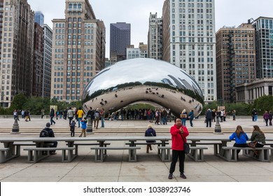 Chicago, Illinois/USA-10/20/2016: Tourists seen in front of the Cloud Gate in Millenium Park in Chicago, Illinois.