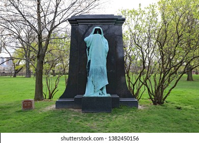 CHICAGO, IL/USA - APRIL 24, 2019:  Lorado Taft's Eternal Silence sculpture in the Graceland Cemetery, in Chicago creates an impact on all who see his work.