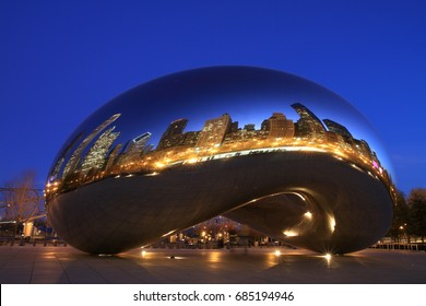 CHICAGO, IL/USA - DECEMBER 1,2009:  Millennium Park at dusk in Chicago, with the reflections of buildings on Cloud Gate, and people enjoying the evening.