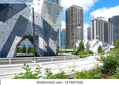 CHICAGO, IL/USA - JULY 24, 2017:  The rock climbing wall in Maggie Daley Park in downtown Chicago, one of several, used by kids, and adults to test their skills in climbing.