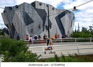 CHICAGO, IL/USA - JULY 24, 2018:  The many rock climbing walls at Maggie Daley Park in downtown Chicago are a major attraction for kids, and parents.  The skating rink is fun too.