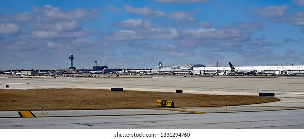 CHICAGO, IL/USA - MARCH 5, 2019:  Panorama of the O'Hare airport in Chicago, Illinois, with control tower, and passenger terminals.