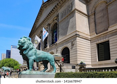 CHICAGO, IL/USA - MAY 14, 2019:  The Art Institute in downtown Chicago, with bronze lions statues in front, greeting visitors.