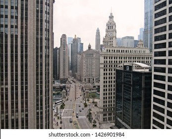 Chicago, IL/USA-10/1/18: Confectioner Mars Wrigley occupies the clock tower building on Michigan Ave.; next door is the dark glass-clad Realtor Bldg.