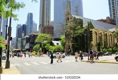 CHICAGO - JULY 10: Pedestrians crossing Michigan Avenue using the crosswalks at the intersection of Delaware and Michigan Avenue on July 10, 2015 in downtown Chicago, Illinois.