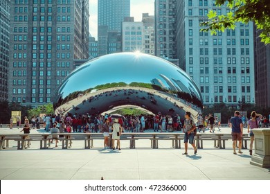 CHICAGO - JULY 2016: Cloud Gate sculpture in Millenium park in Chicago, IL. This public sculpture is the centerpiece of the AT&T Plaza in Millennium Park within the Loop community area.