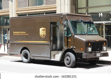 CHICAGO - JUNE 27: UPS driver delivers packages on June 27, 2013 in Chicago. UPS is one of largest package delivery companies worldwide with 397,100 employees and USD 54.1 billion revenue (2012).