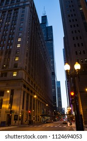 Chicago Loop downtown city street night scenery with skyscrapers