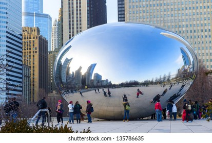 CHICAGO - MARCH 14 : View of the  Cloud Gate sculpture in Millennium Park in Chicago on March 14 2013 , The sculpture is nicknamed The Bean , designed by British artist Anish Kapoor.