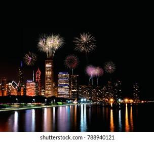 Chicago night skyline across Lake Michigan with fireworks.