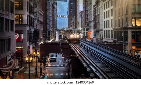 Chicago : October 10, 2018, Train on elevated tracks within buildings at the Loop, Glass and Steel bridge between buildings - Chicago City Center - Chicago, Illinois, USA