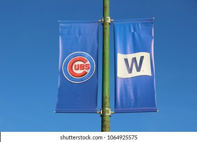 """CHICAGO - OCTOBER 2016: Banners Fly at Wrigley Field in October 2016 in Chicago. Fans in Chicago """"Fly the W"""" to support the Chicago Cubs."""
