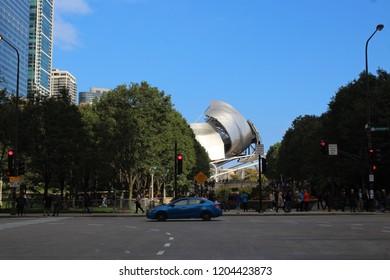 CHICAGO - OCTOBER 2018: Jay Pritzker Pavilion, AKA Pritzker Pavilion or Pritzker Music Pavilion, in October 2018 in Chicago. The pavilion is seen in Millennium Park from Randolph Street.