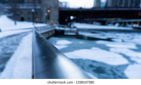 Chicago River is completely frozen over mid January.  everything is ice cold blue.   abstract view of river for a blurred perspective