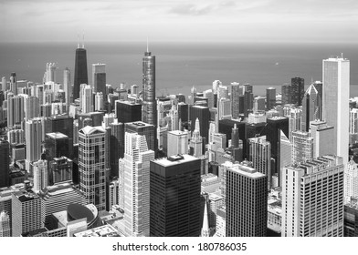 Chicago skyline aerial view with skyscrapers over Lake Michigan black and white.