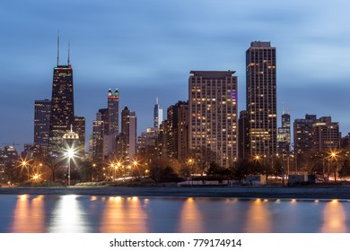 Chicago skyline with lake Michigan in foreground with blue sky