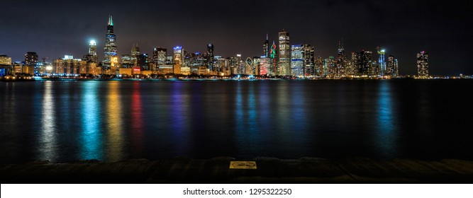 Chicago skyline at night, water reflections