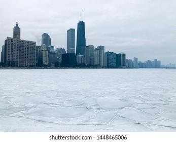 Chicago Skyline Overlooking Frozen Lake Michigan