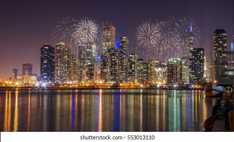 Chicago skyline with Reflection from Lake Michigan with Fireworks